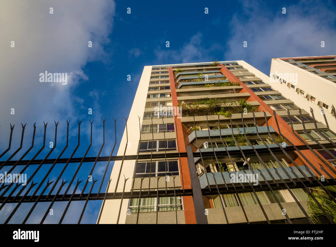 Upmarket residential tower block protected by high fence, Salvador, Bahia, Brazil - Stock Image