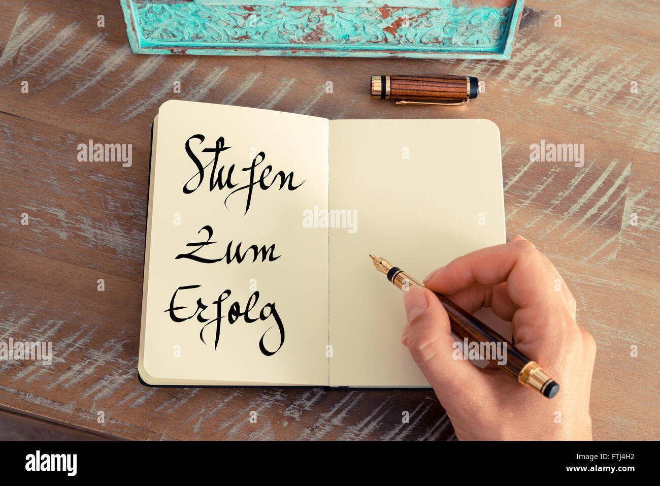 Handwritten text in German 'Stufen Zum Erfolg'  - translation : Steps To Success as business concept image - Stock Image