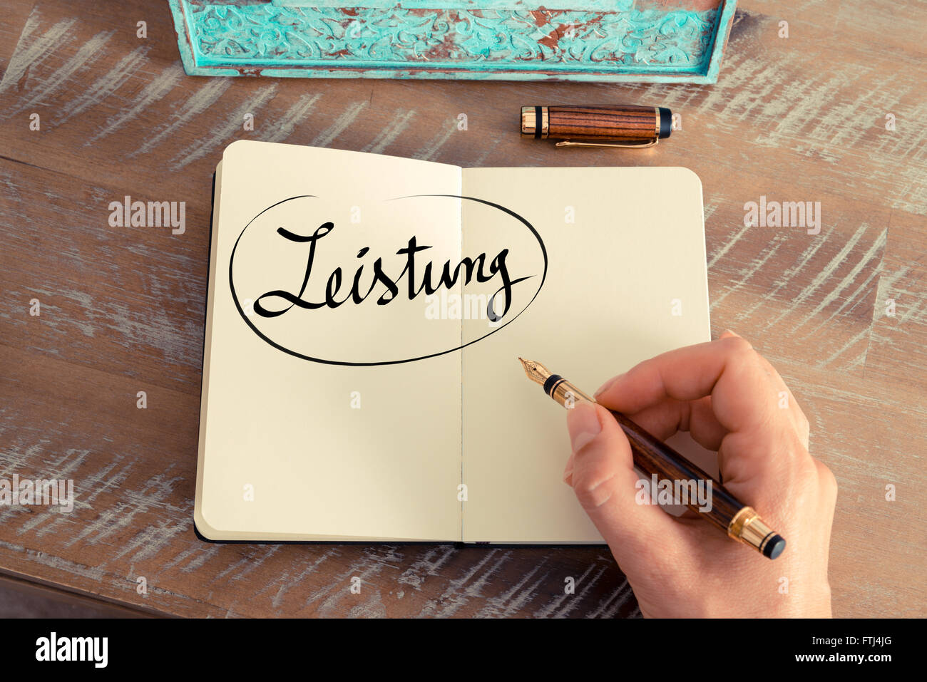 Handwritten text in German 'Leistung '  - translation : Power as business concept image - Stock Image