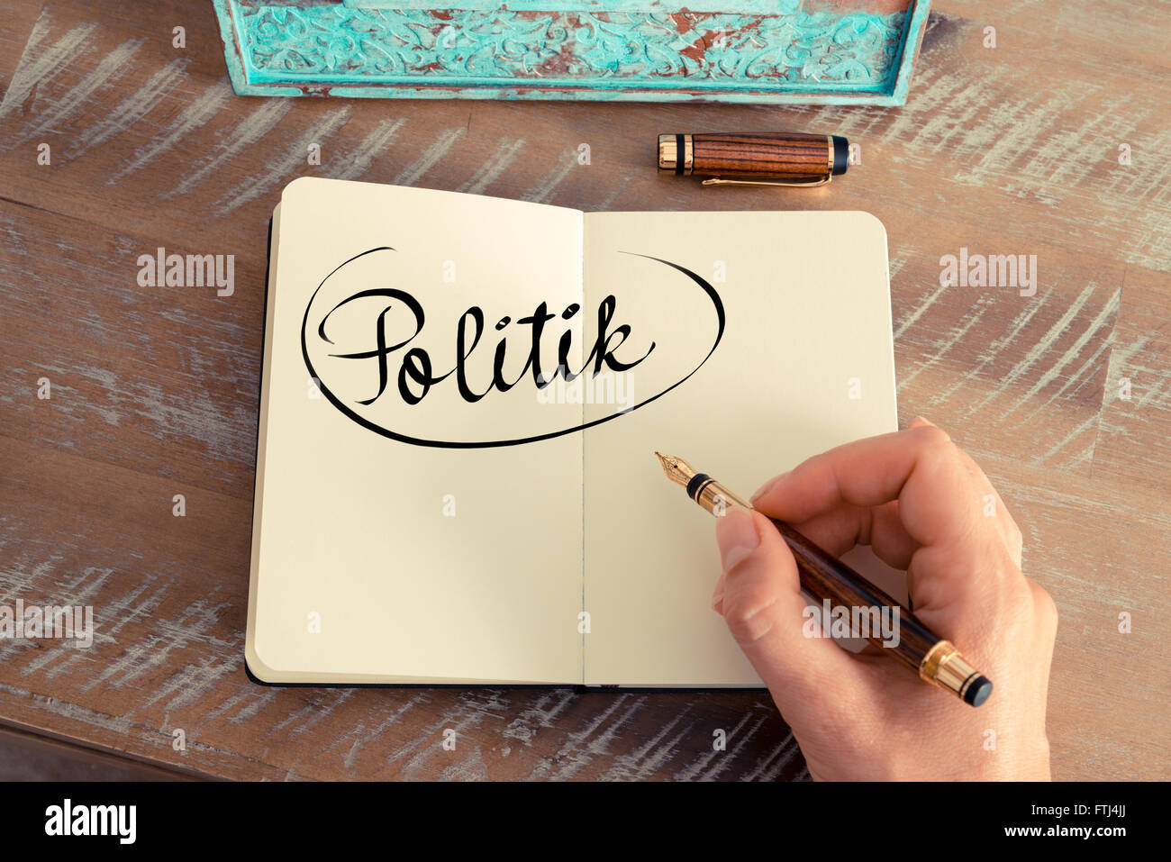 Handwritten text in German 'Politik'  - translation : Politics as business concept image - Stock Image