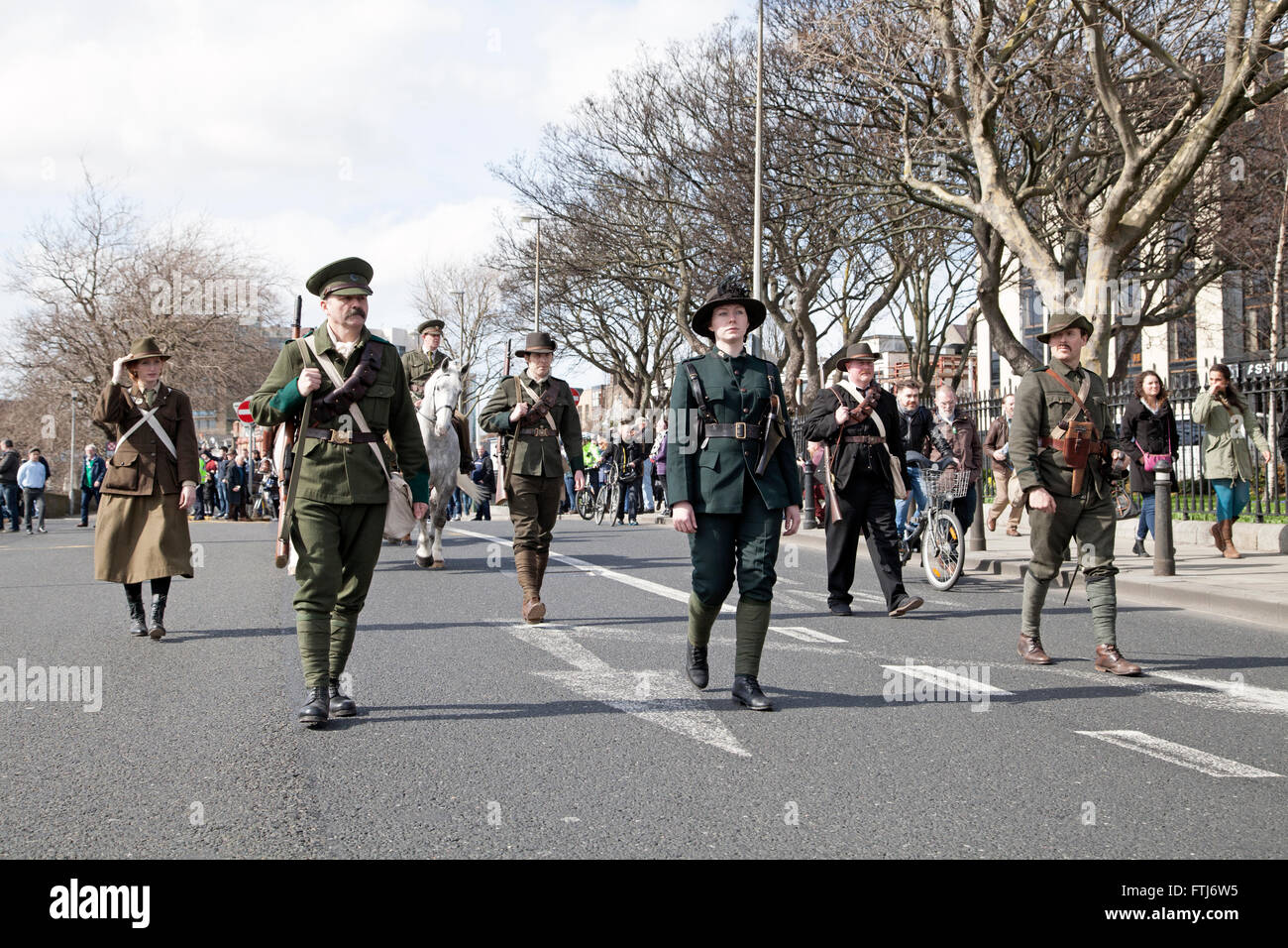 Actors portraying the 1916 Easter Rising leaders marching through Dublin city, Ireland. Stock Photo
