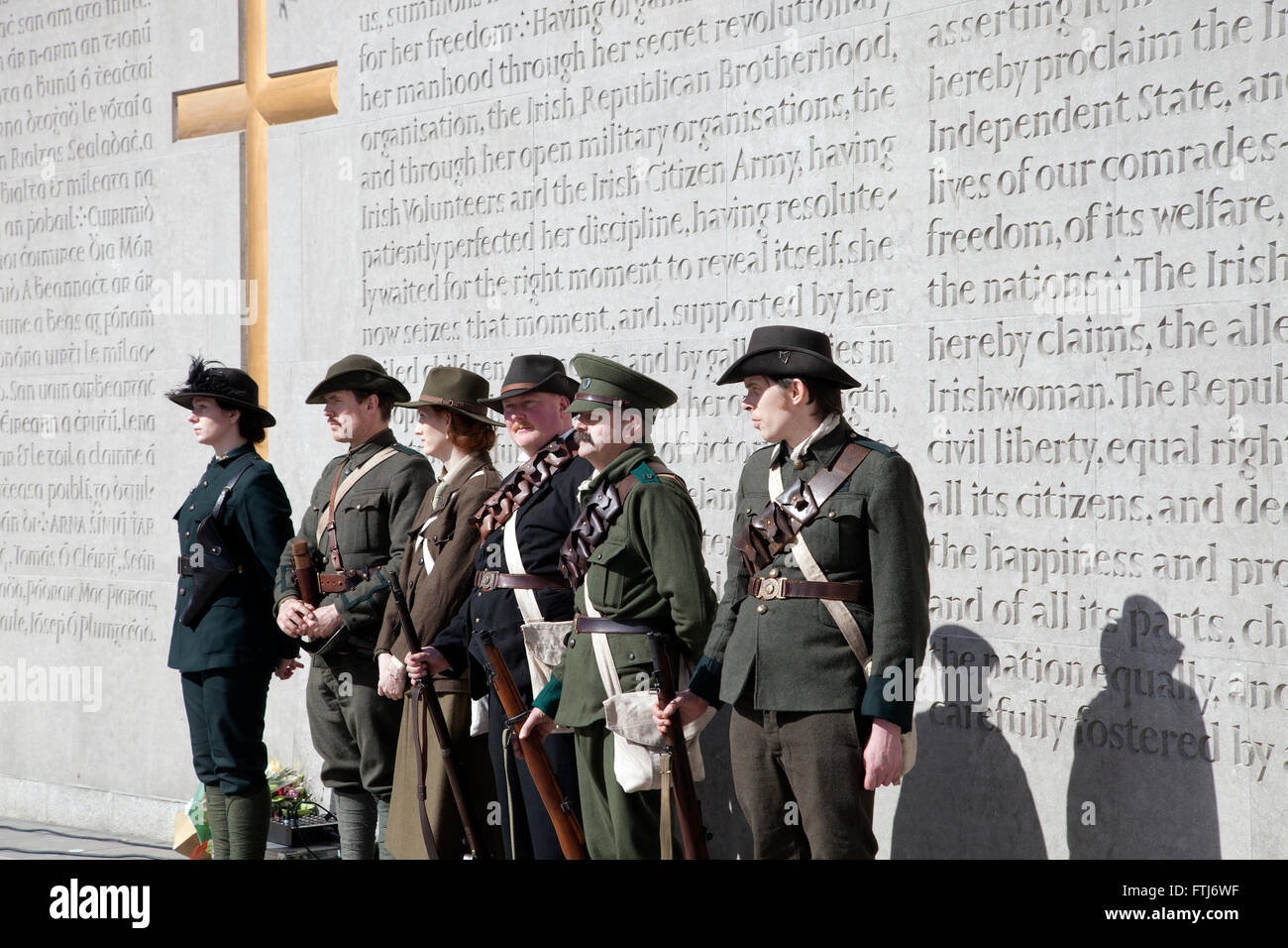 Actors portraying the 1916 Easter Rising leaders at Arbor Hill Cemetery in Dublin city, Ireland. - Stock Image