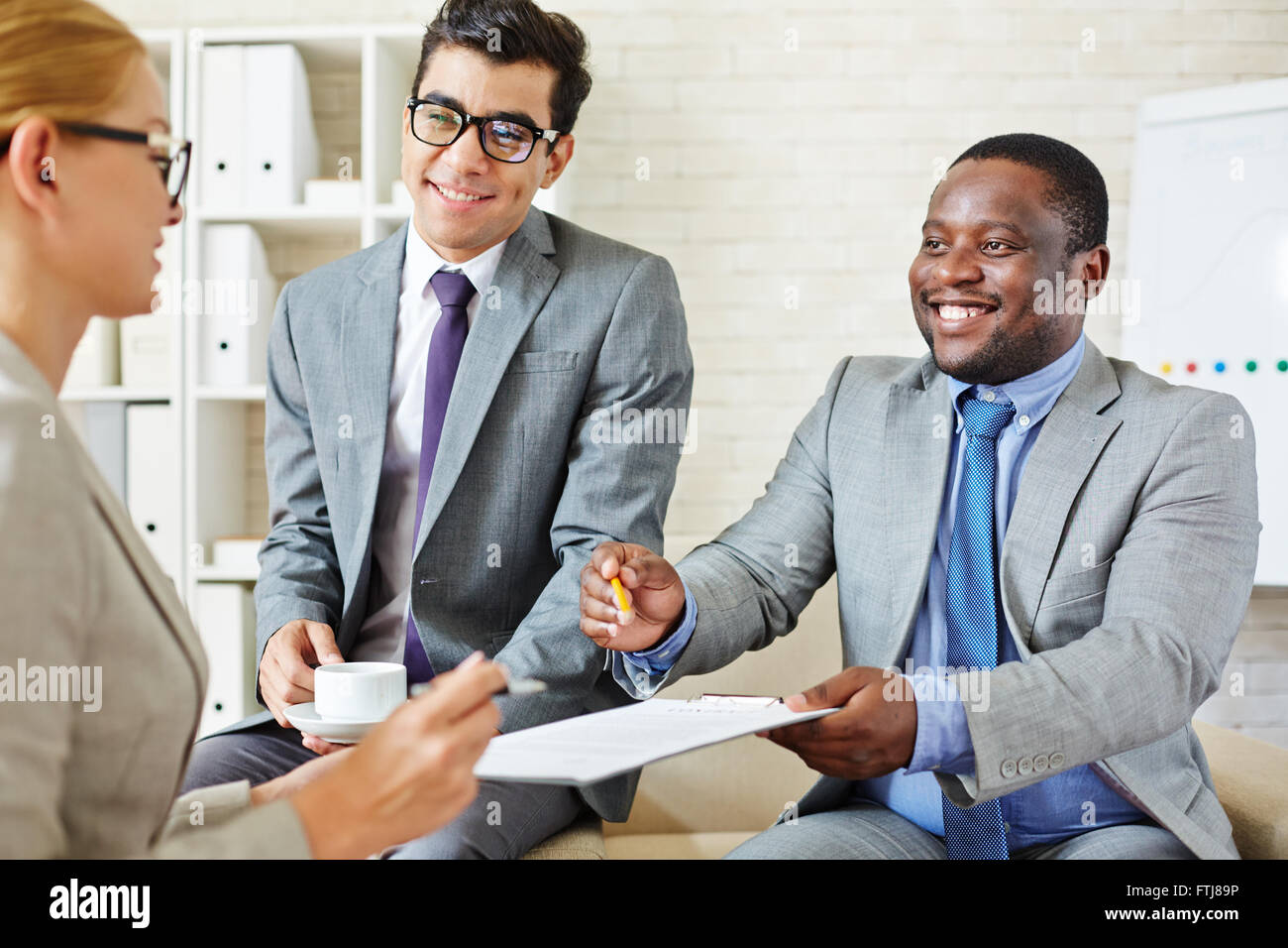 Offering to sign contract - Stock Image