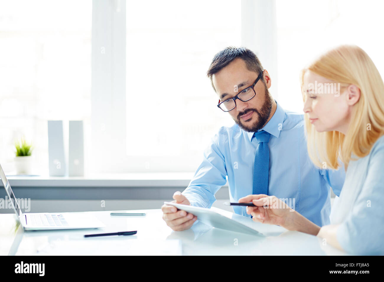Colleagues interacting - Stock Image
