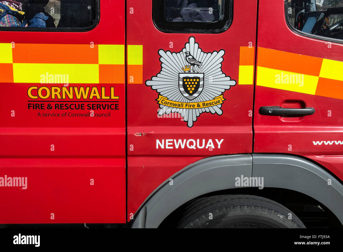 The crest of the Cornwall Fire & Rescue Service on the side of a Cornish Fire Engine. - Stock Image