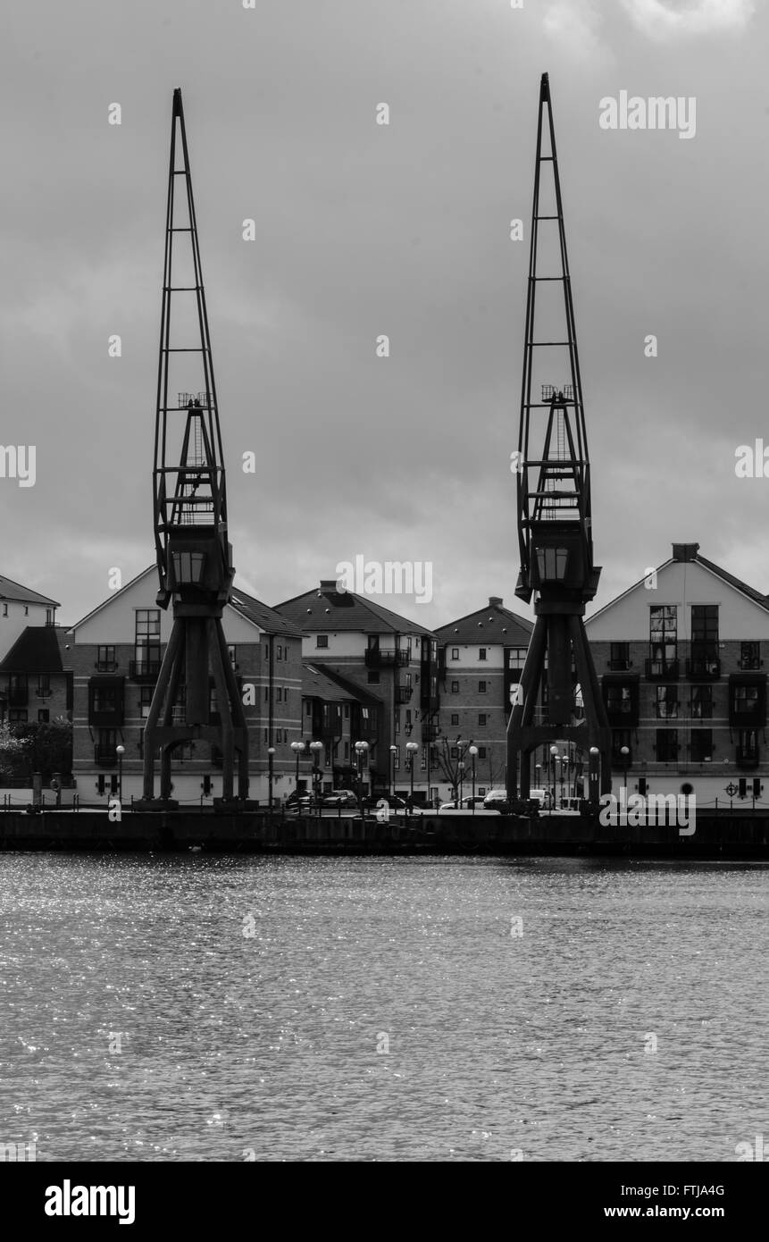 A view of modern town houses on the edge of the Royal Victoria Dock in the Docklands area of London. - Stock Image