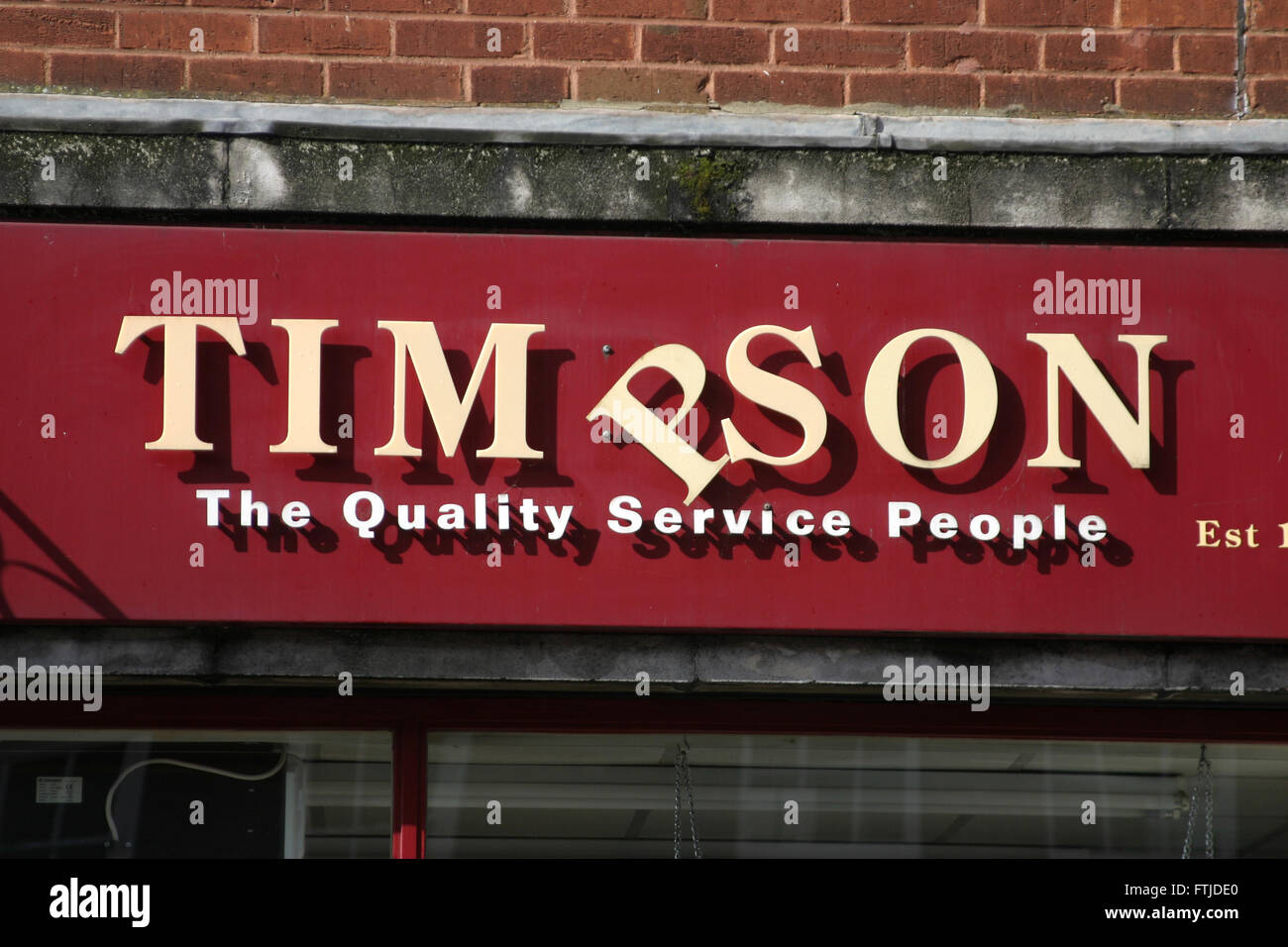 timpson key cutting shoe repairs watches battery high street - Stock Image