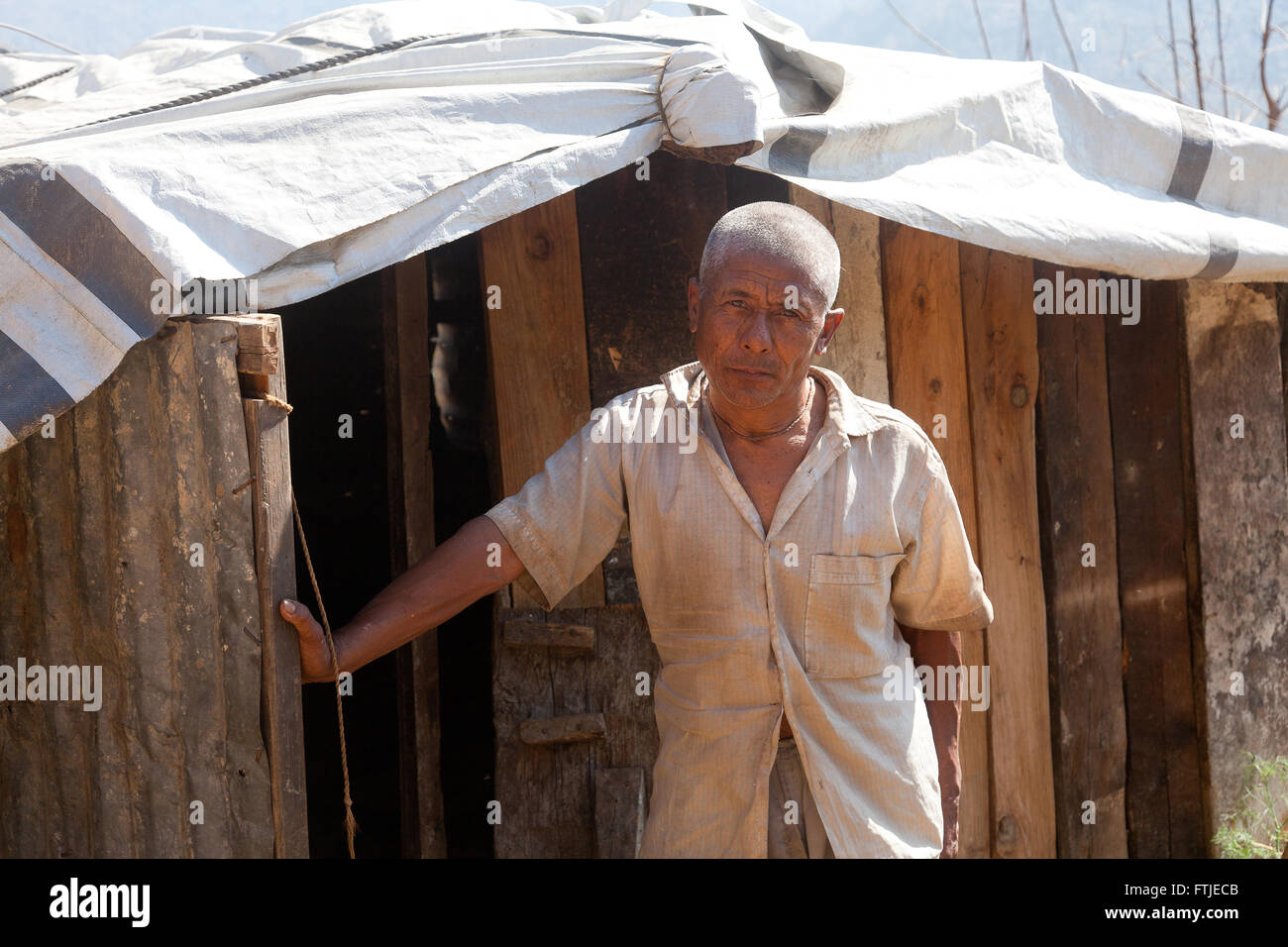 Nil Bahadur Napit (69) outside his shelter in Phataksila, Sindhupalchowk, Nepal - Stock Image