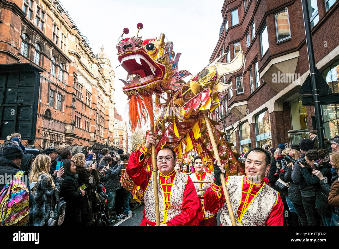 In London thousands of people celebrate the Chinese New Year 2016 - The Year of the Monkey. - Stock Image