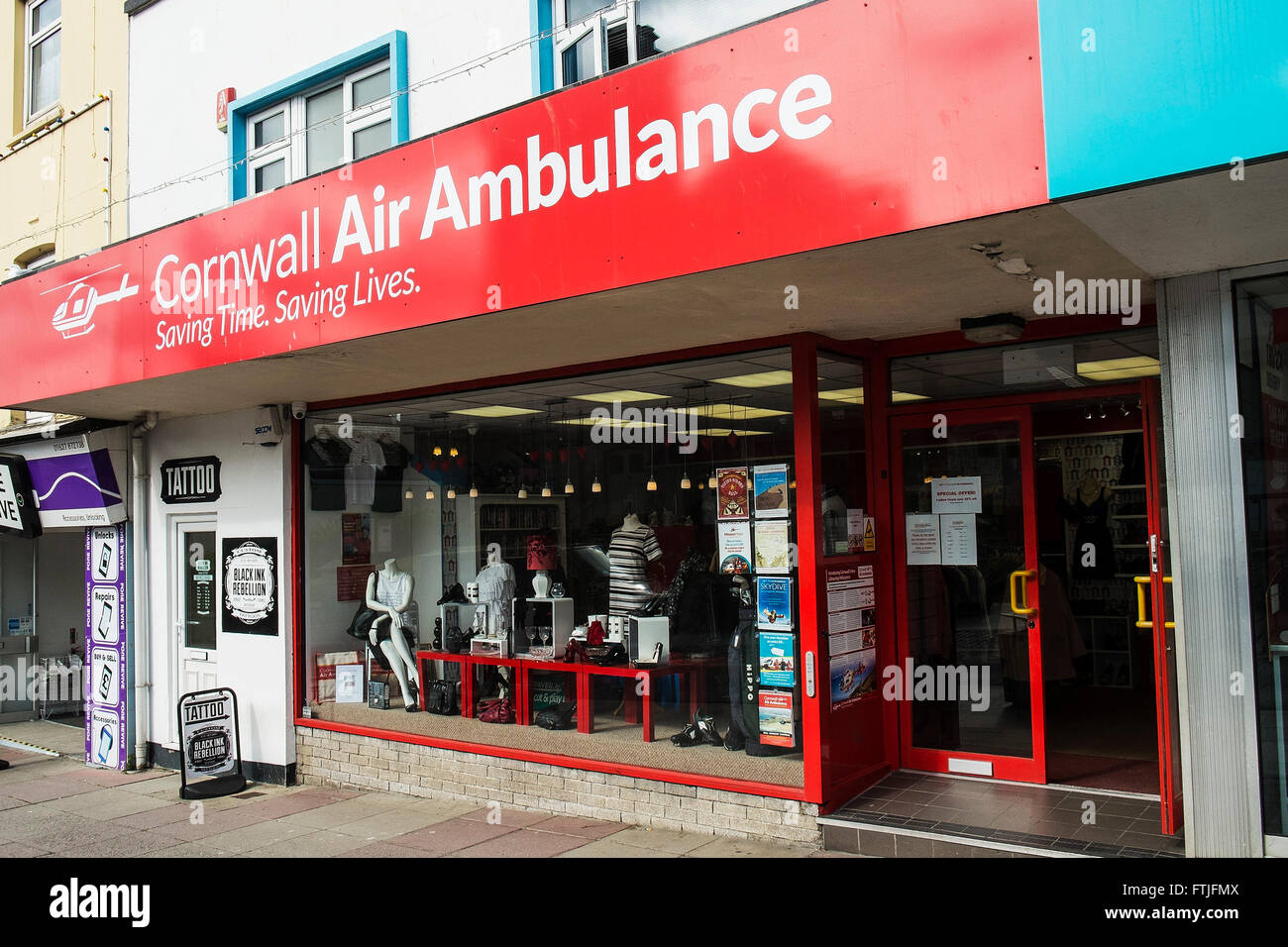 The Cornwall Air Ambulance charity shop in Newquay, Cornwall. - Stock Image