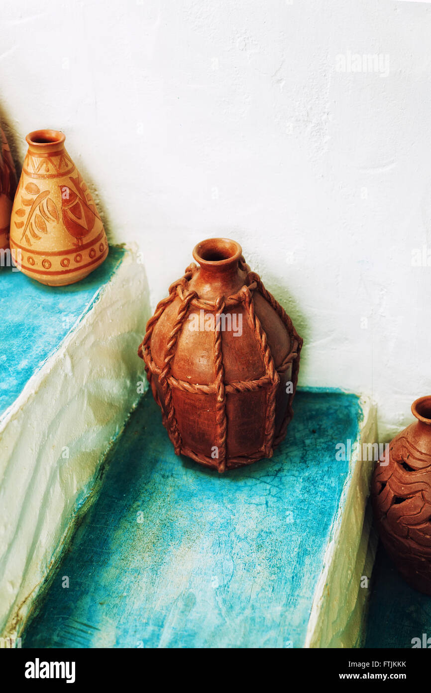 Сlay jugs on the steps of the house - Stock Image
