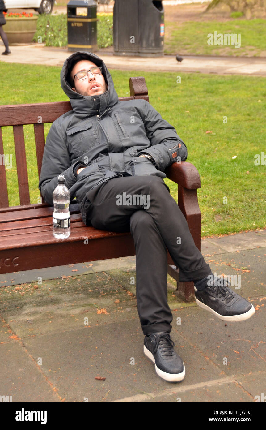 London, UK, 29 March 2016, man snoozes in Soho Square on rainy day in Soho after storm Katie passes. Credit:  JOHNNY - Stock Image