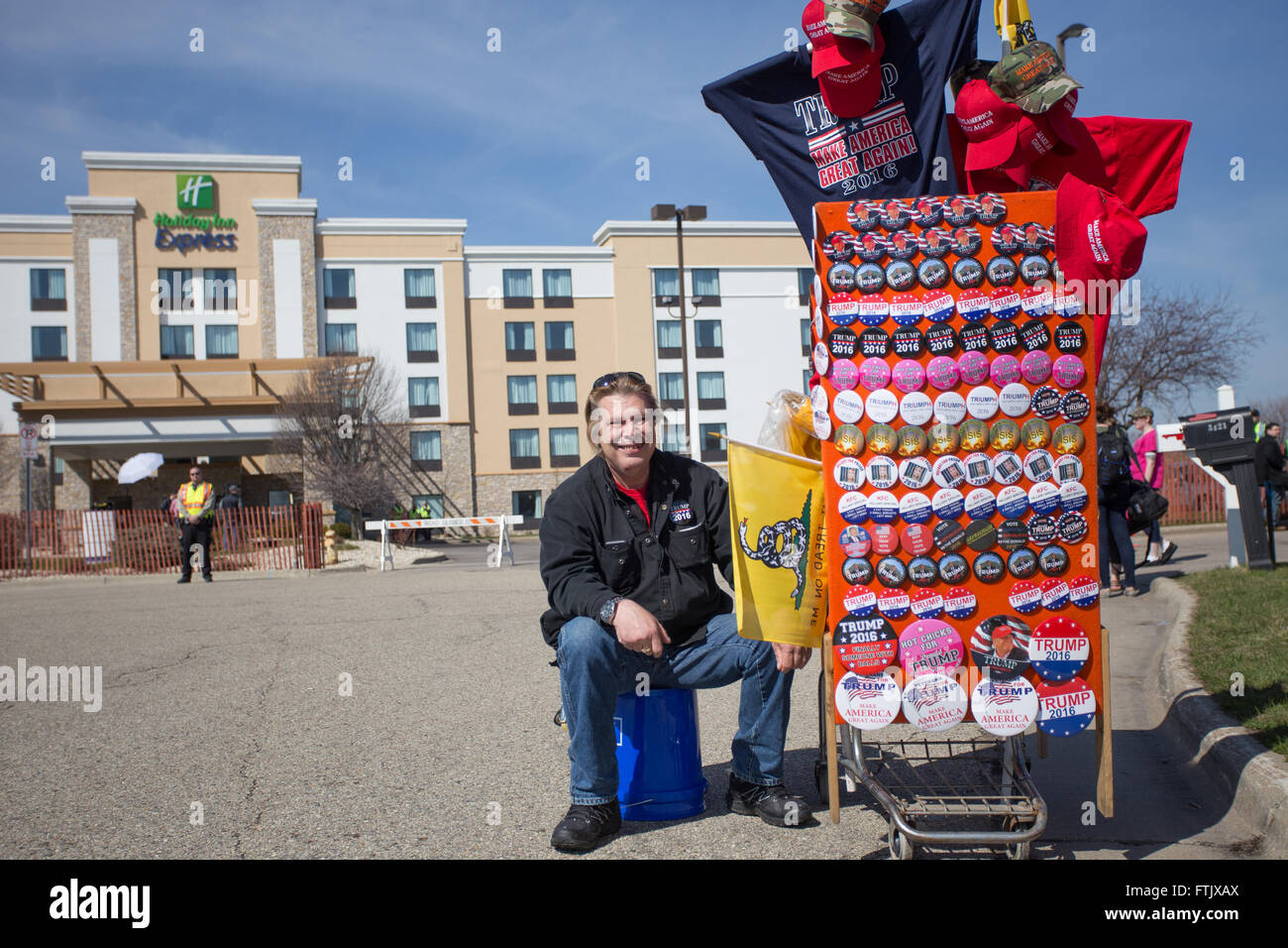 Milwaukee, WI. March 29th, 2016. Donald J. Trump supporter sits in front of the Janesville Holiday Inn Express with - Stock Image