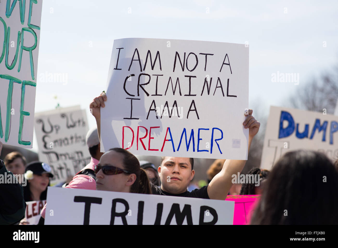 Milwaukee, WI. March 29th, 2016. Donald Trump Janesville protester holds a sign saying 'I am not a criminal - Stock Image