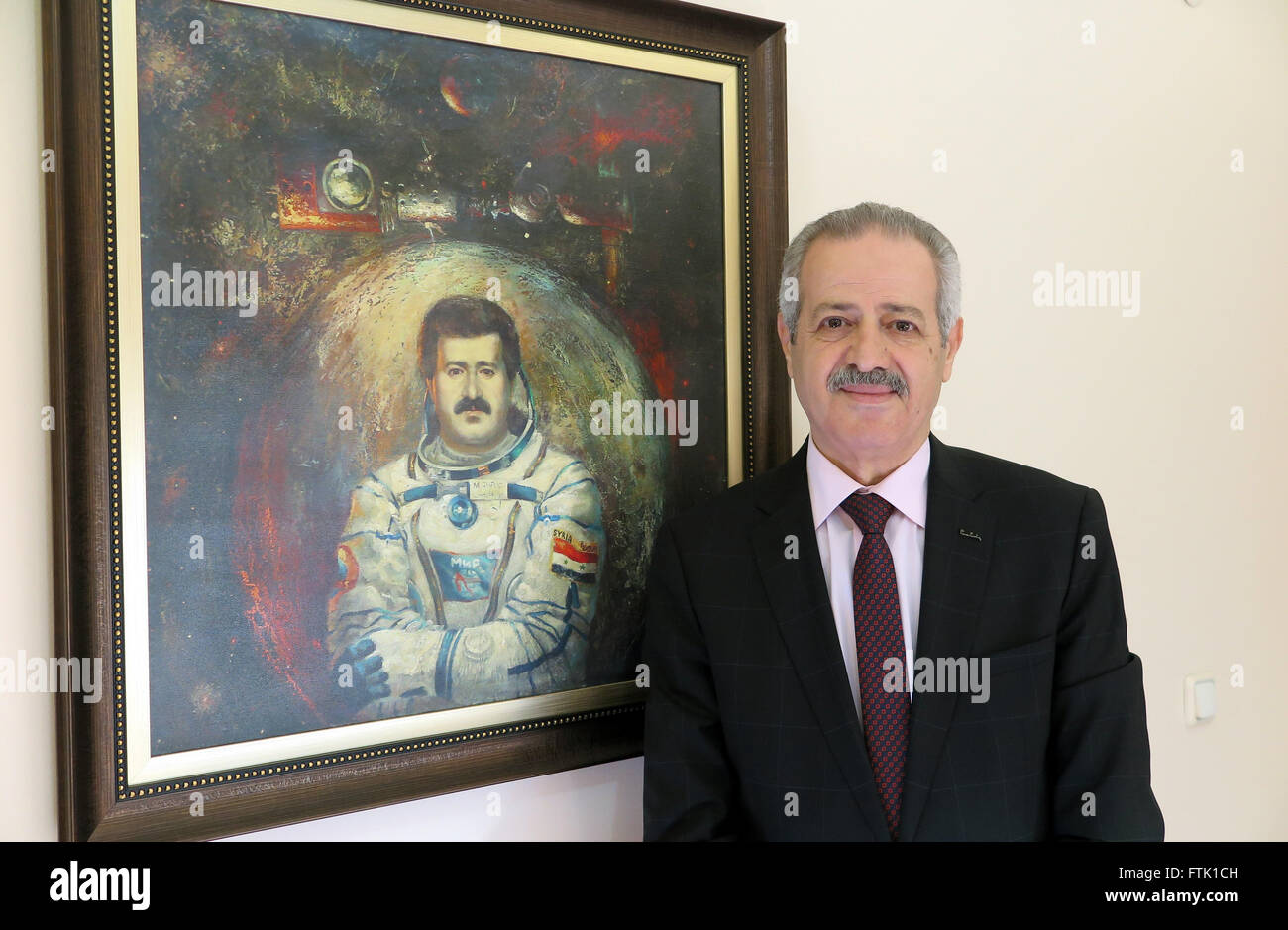 Istanbul, Turkey. 11th Mar, 2016. Muhammed Faris, the first Syrian astronaut, stands next to a painting of him in - Stock Image