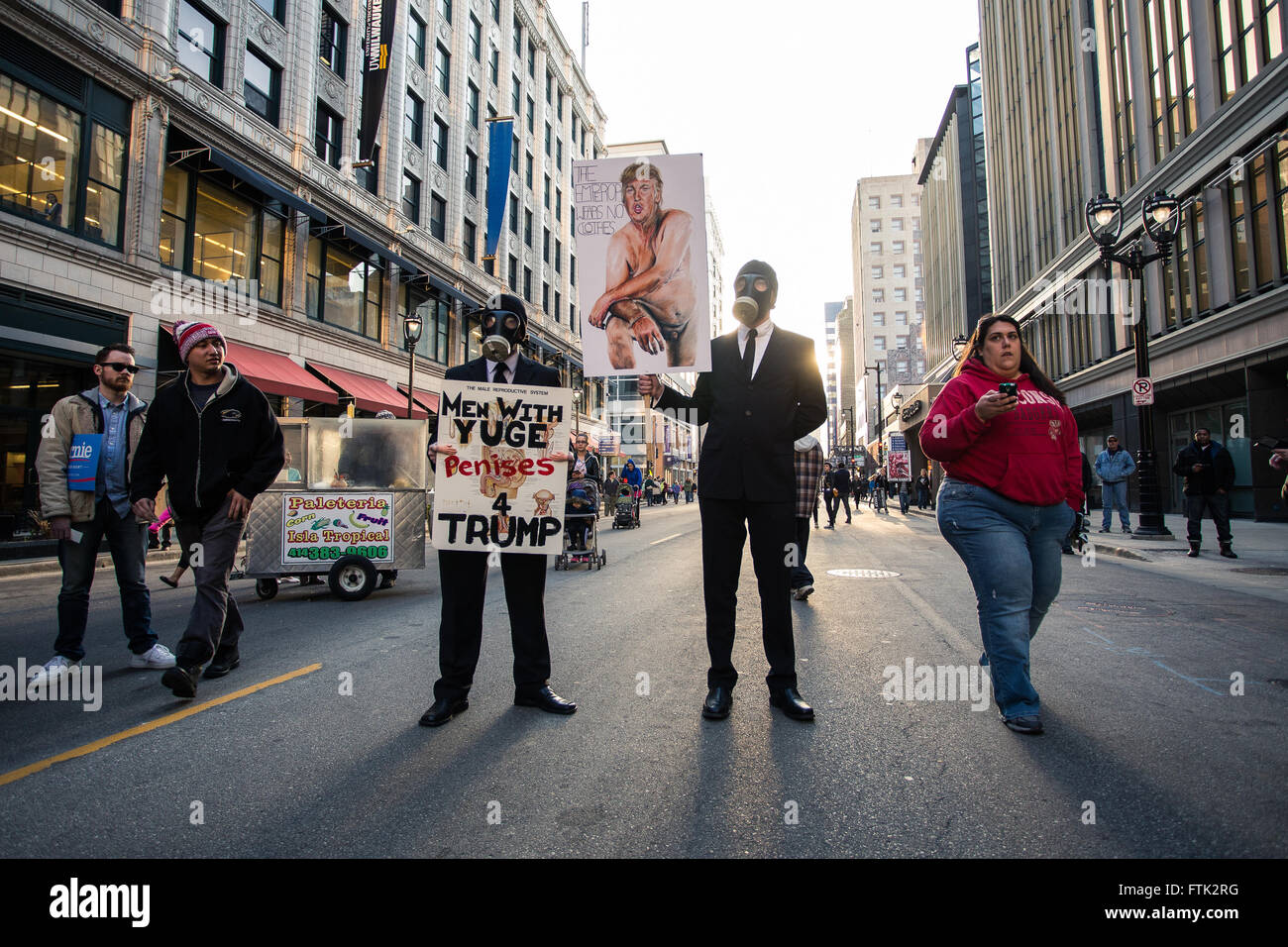 Milwaukee, WI. March 29th, 2016. Two men stand with signs saying 'Men with Yuge Penises 4 Trump'. These - Stock Image