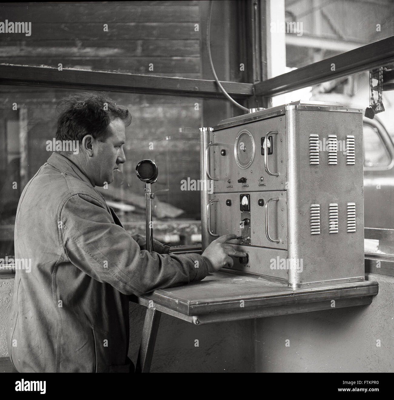 1950s historical, male operator sending a cable message from the ...
