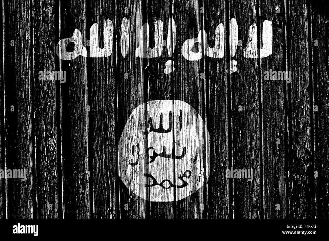 flag of Islamic State of Iraq and the Levant painted on wooden frame Stock Photo