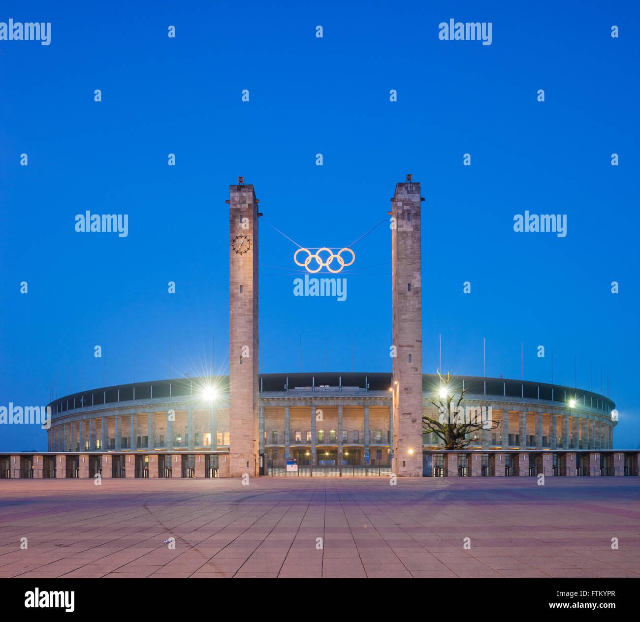 Berlin's Olympic Stadium (Olympiastadion) at twilight - Stock Image
