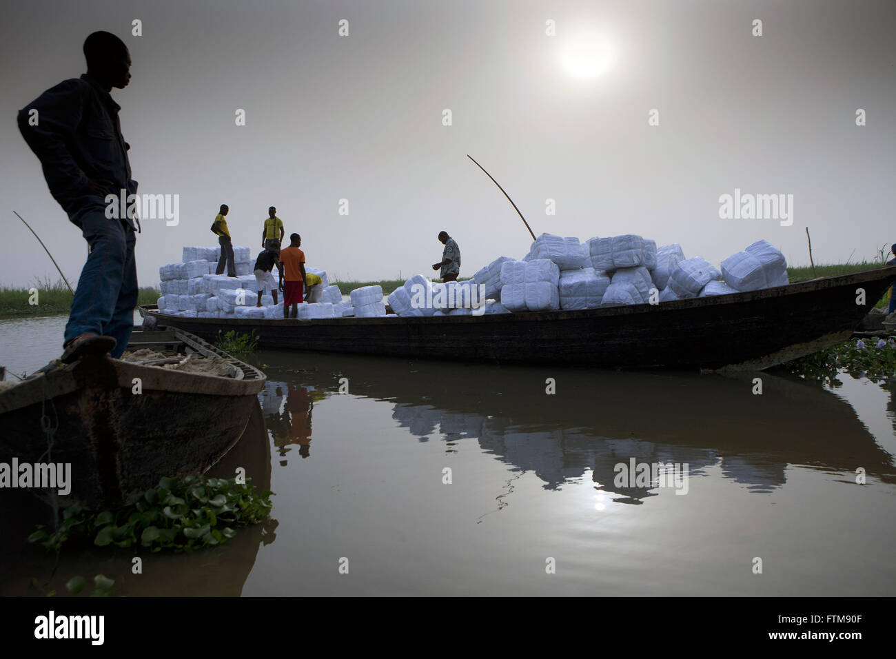 Transportation clothing UN humanitarian aid to the village of So Ava located on Lake Nokue - Stock Image