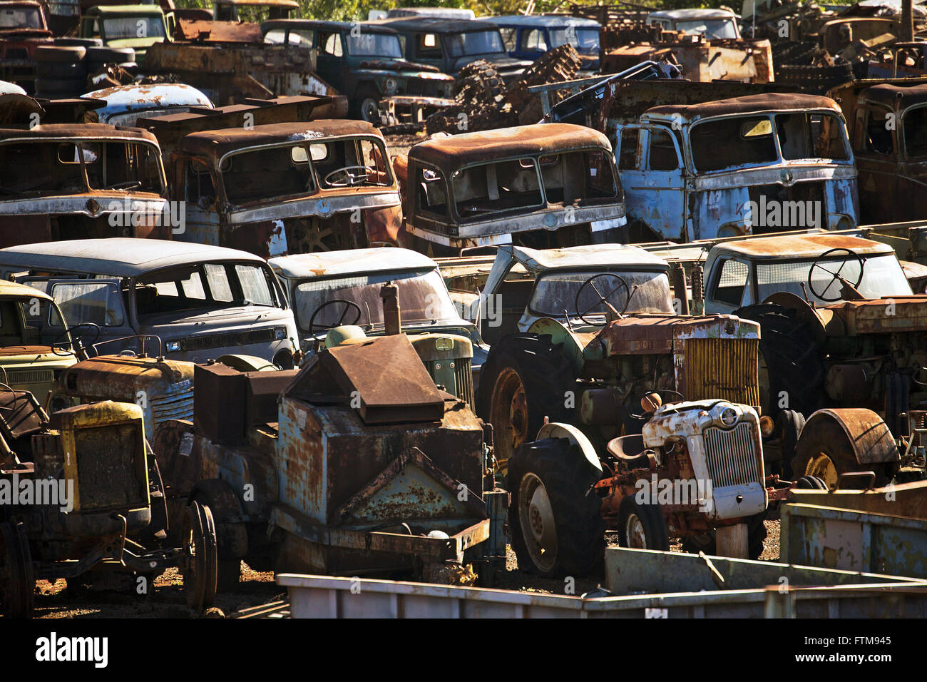 Patio with junk cars and trucks Stock Photo