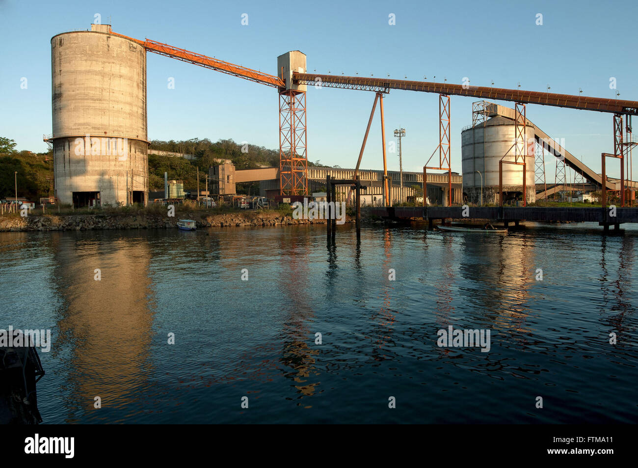 Grain storage silos and conveyor belt at the Port of Aratu - Stock Image