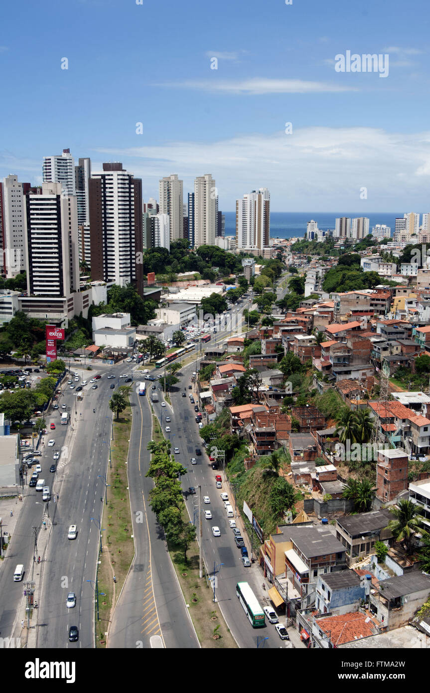 Top view of Avenue Vasco da Gama with residential buildings to the left and right favela - Stock Image