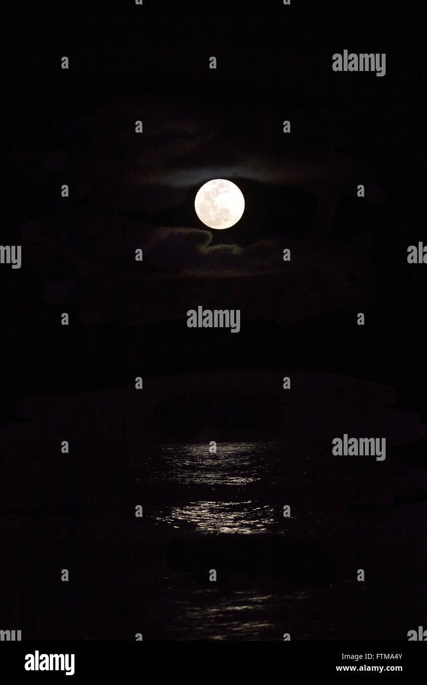 Full moon rising in the sea - Peninsula of Marau - Stock Image