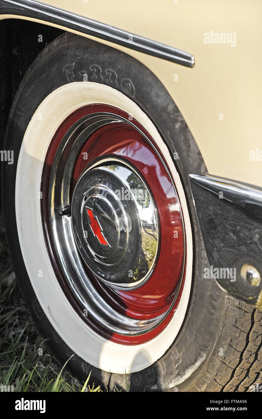 Detail of tire with white band on exhibition of old veicilos - Stock Image
