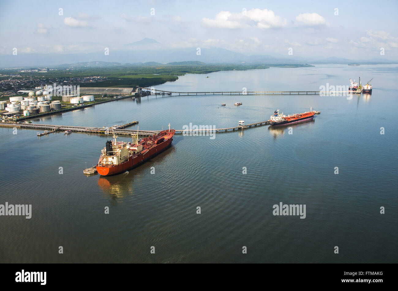 Aerial view of freighters moored at pier of fuels and fertilizers in the private area of the port - Stock Image