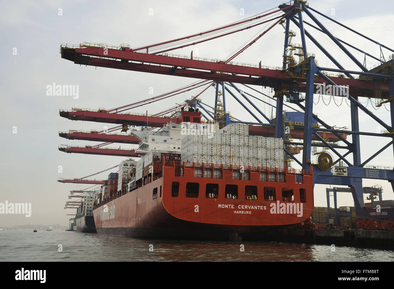 Cargo ship being loaded at the Port of Santos Stock Photo