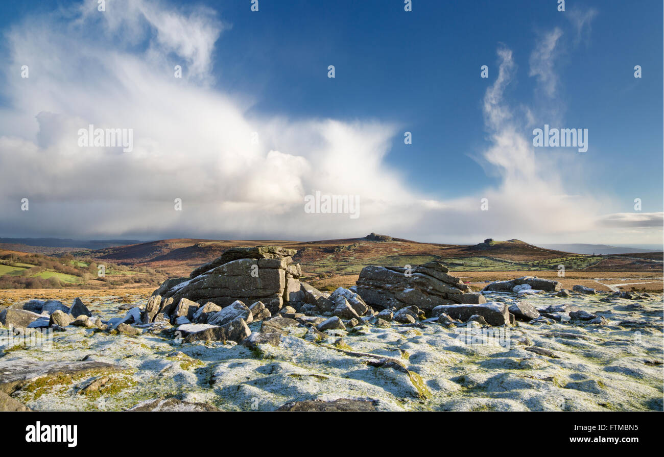 View from Top Tor to Haytor and Saddle Tor on Dartmoor on a winter's morning with dusting of snow. - Stock Image
