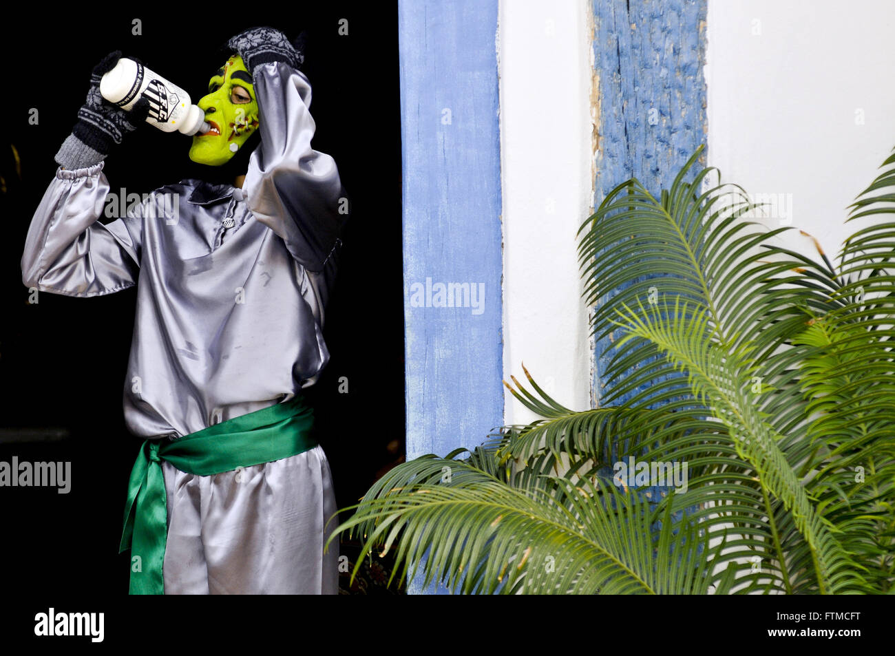 Masked - present during Cavalhadas town character moment of rest - Stock Image