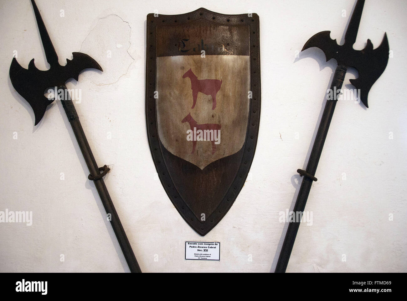 Weapons and shield insignia with Pedro Alvares Cabral in Forte Sao Joao - Stock Image