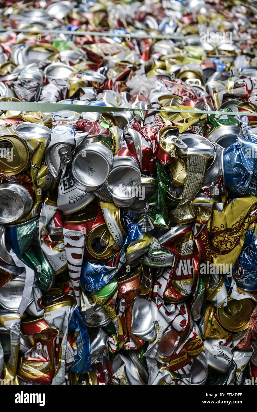 Detail of burden with aluminum cans produced by recycling cooperative - Stock Image