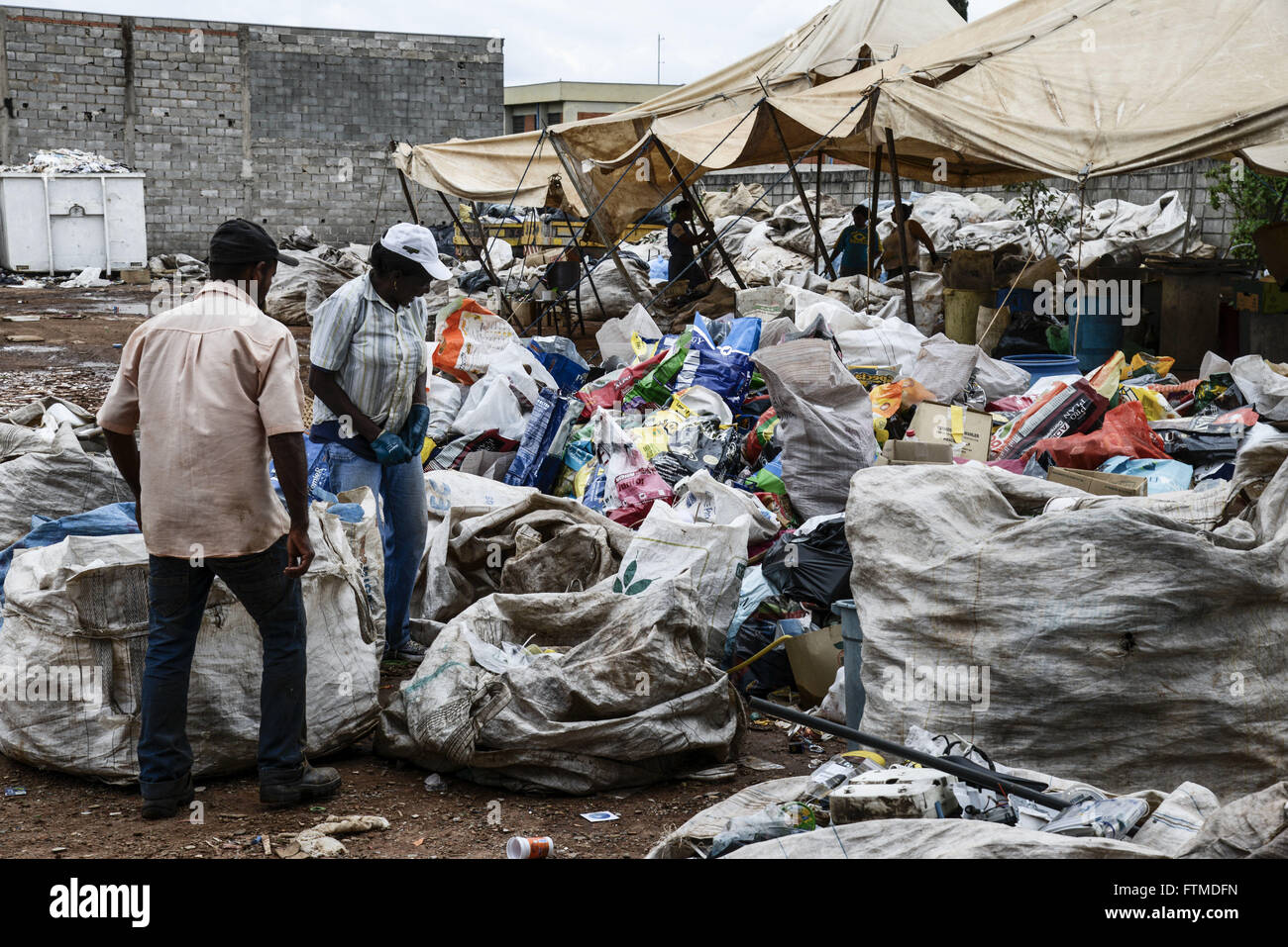 Means workers recyclable raw material recycling cooperative - Stock Image