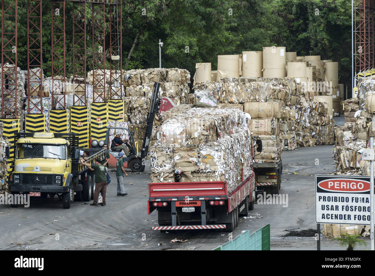 Trucks with bales of recyclable material that will be transformed into wrapping paper - Stock Image