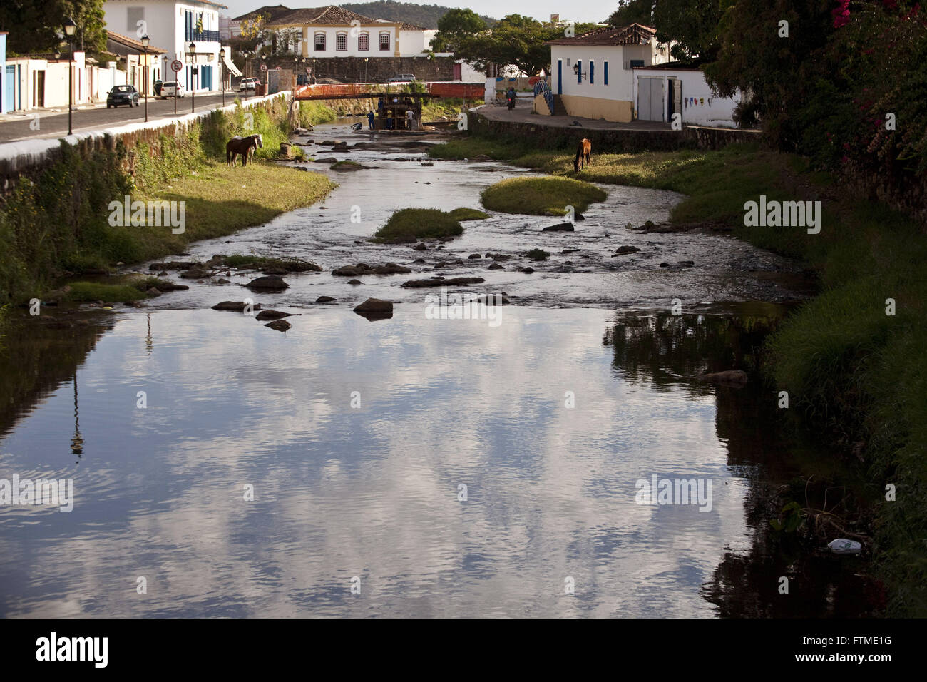 Red River in the historic city of Goias with reflected sky - Stock Image