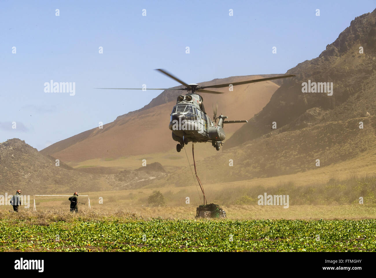 Super Puma helicopter of the Brazilian Navy doing transport on the Island of Trinidad - Stock Image