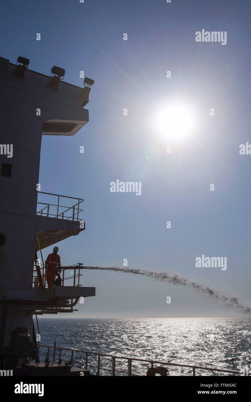 Foreman handles cannon fire-fighting ship Maisa - tanker PETROBRAS - Stock Image