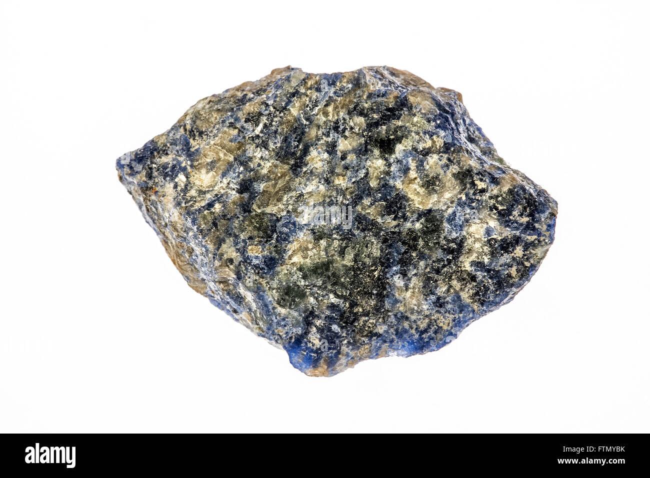 Sodalite, royal blue tectosilicate mineral specimen, on white background - Stock Image