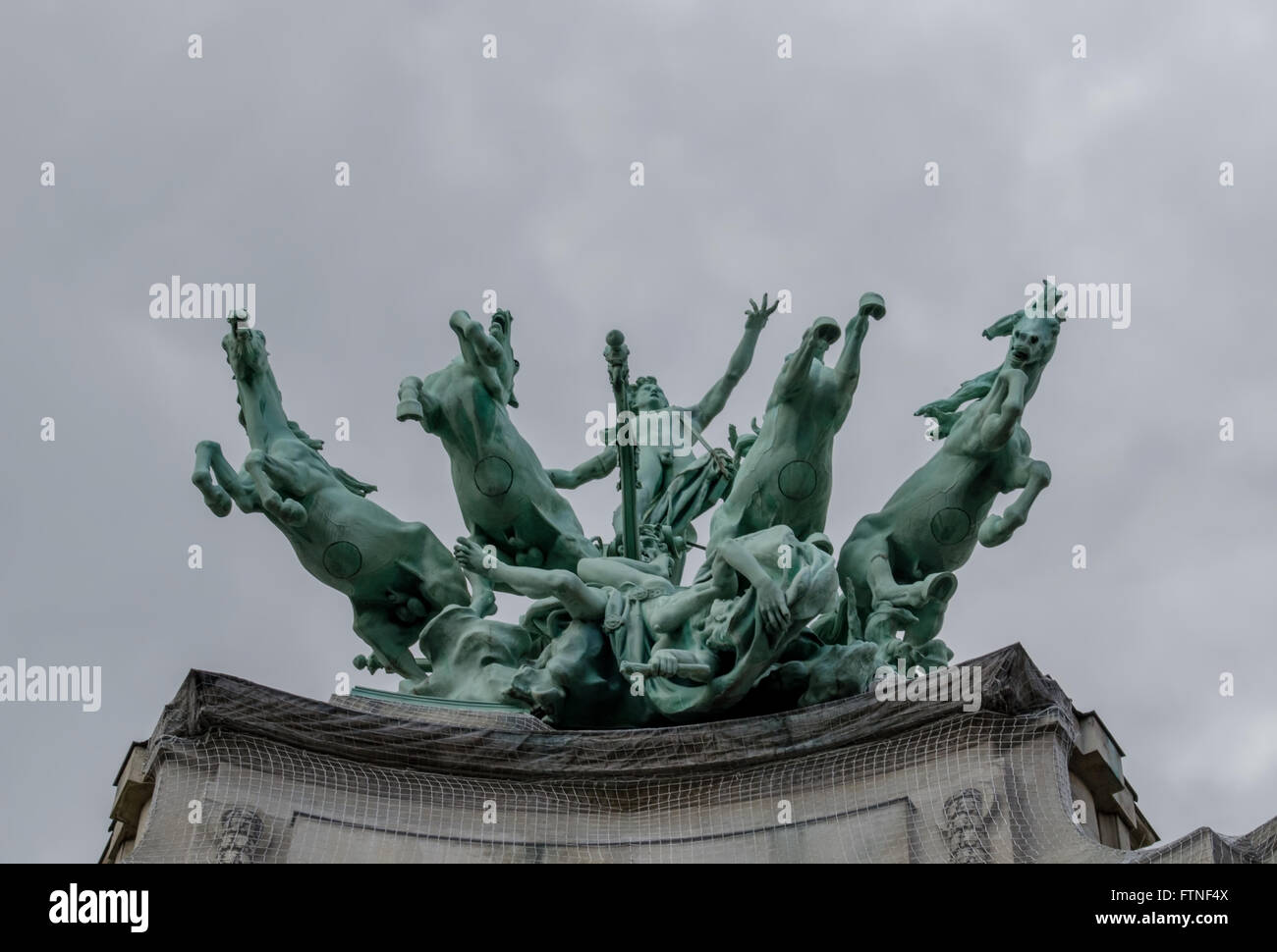 A statue of horses from below in Paris, France - Stock Image
