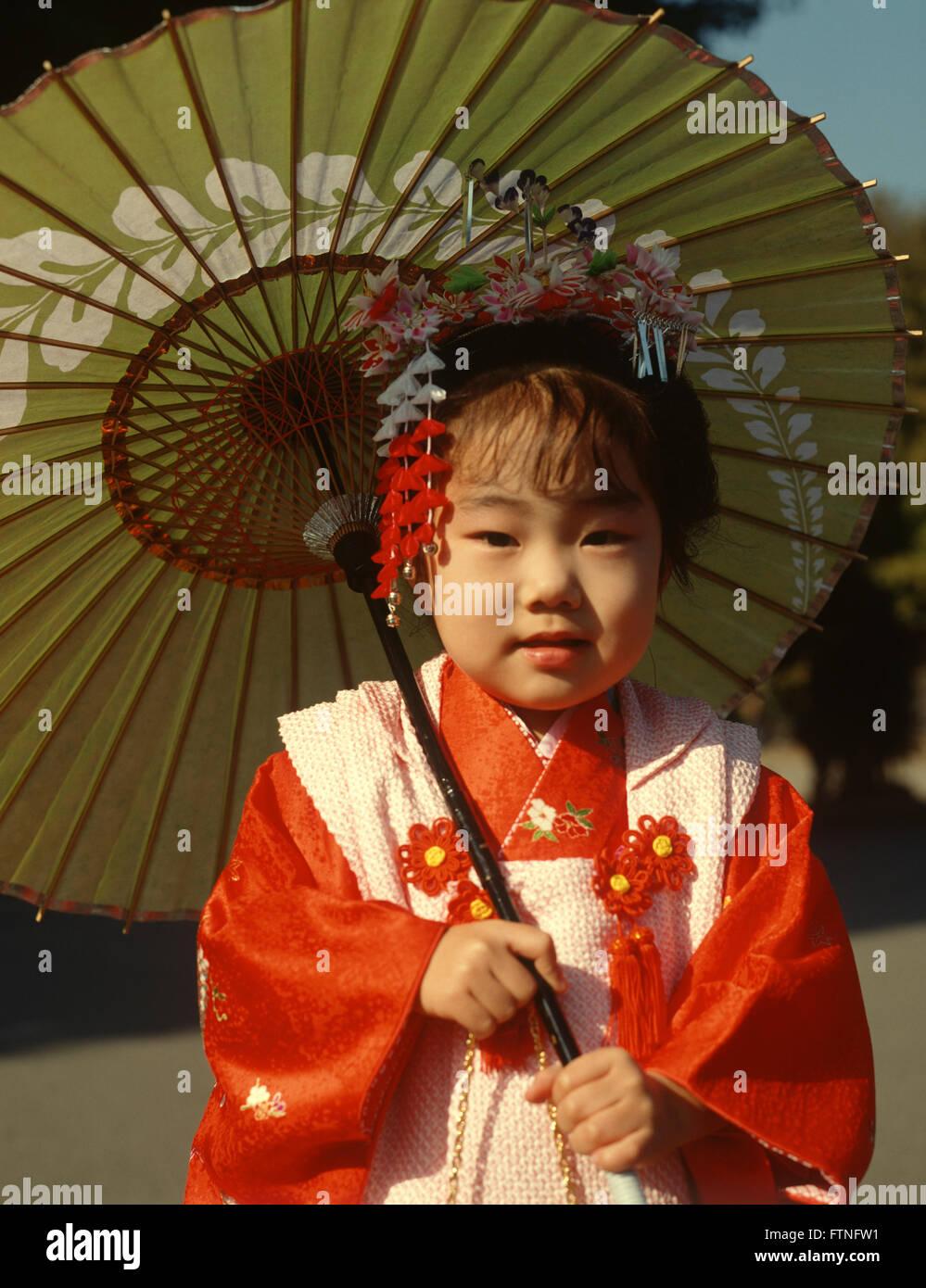 Japan Japanese child in traditional Kimono costume holding a sunshade.  sc 1 st  Alamy & Japan Japanese child in traditional Kimono costume holding a Stock ...