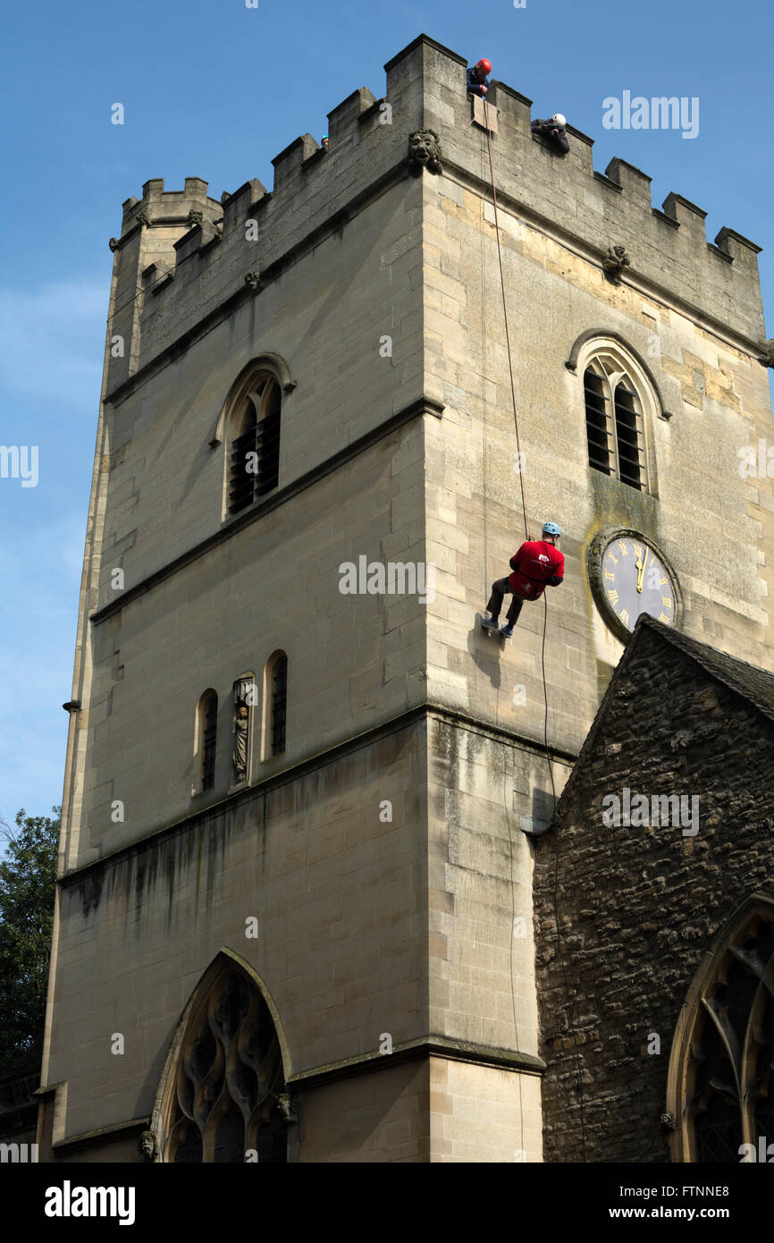 Person abseiling down St. Mary Magdalen`s Church, Oxford, UK Stock Photo