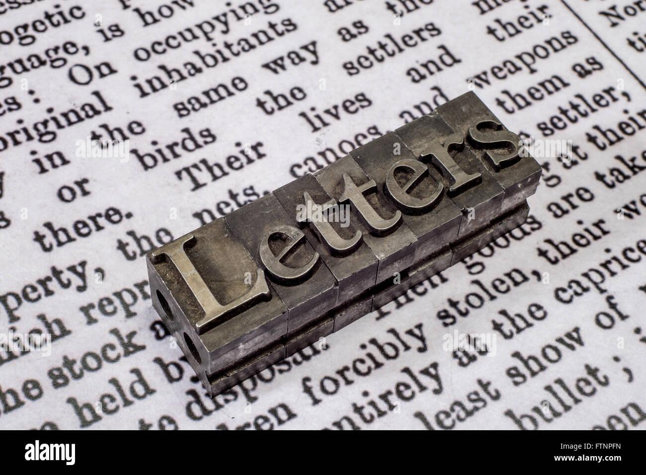 Printing press block letters on newspaper print arranged to display