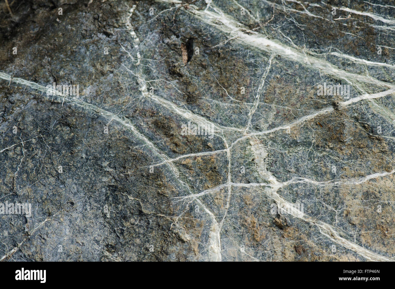 Rock surface veined with white layers. Spain - Stock Image