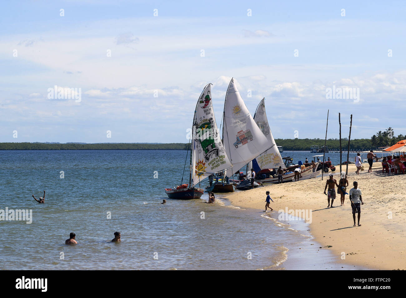Sailboats and swimmers in Barra do Cunhau - Stock Image