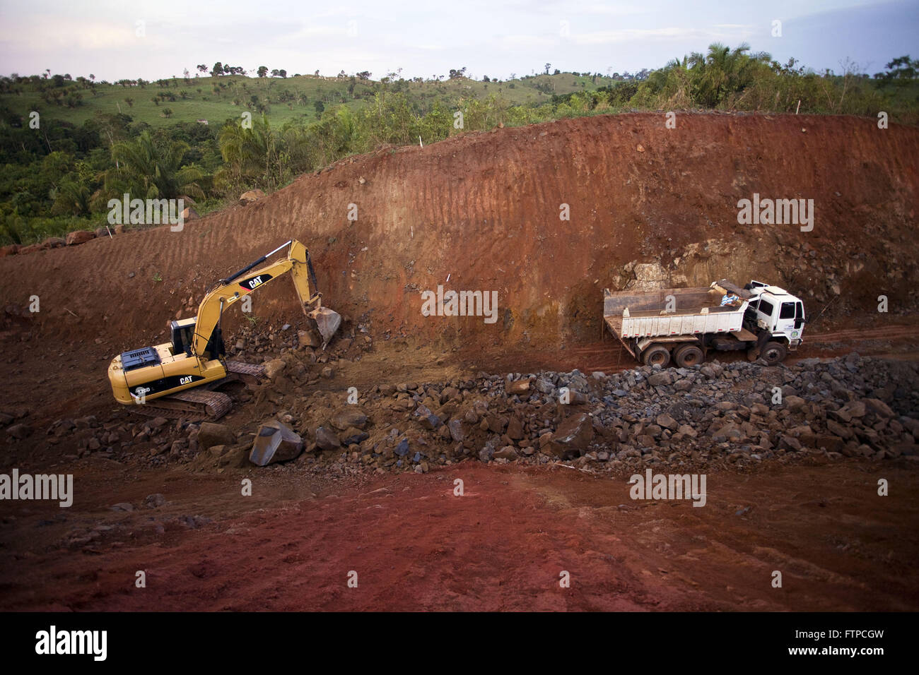 Earth mover by hillside. - Stock Image