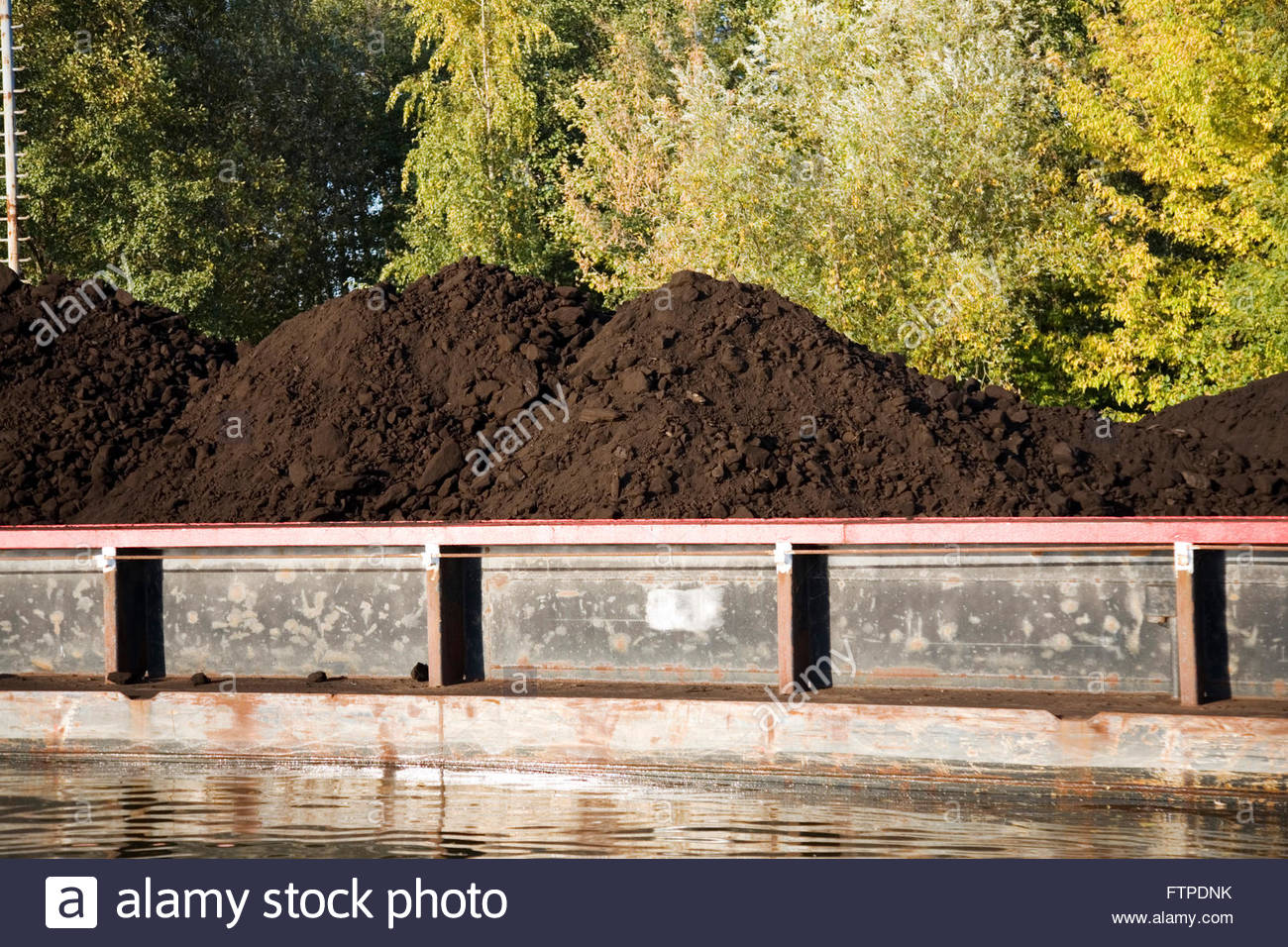 Brown coal loaded on a barge in Germany Stock Photo