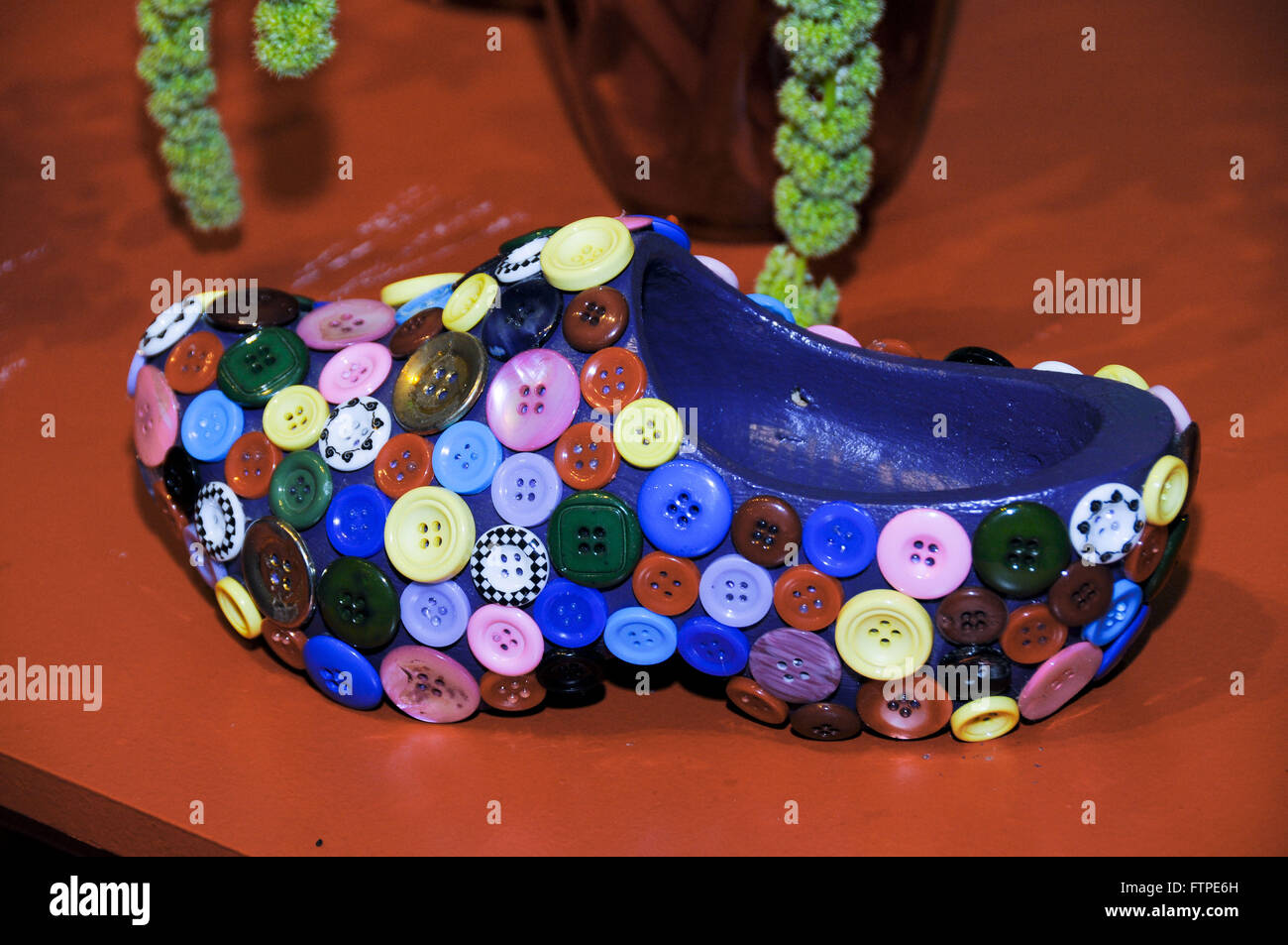Dutch clog trimmed with buttons on the grounds of Expoflora - Stock Image